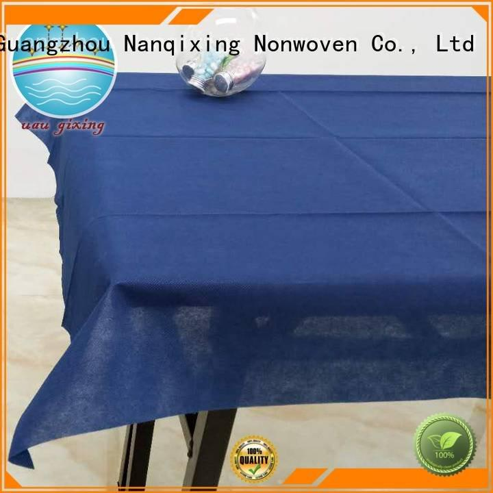 Nanqixing Brand spunbond perforated non woven tablecloth colours nonwoven